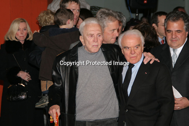 Kirk Douglas &amp; Jack Valenti<br />Grauman&rsquo;s Chinese Theater Handprint and Footprint Ceremony honoring Jack Valenti<br />Grauman&rsquo;s Chinese Theatre<br />Hollywood, CA, USA<br />Monday, December 06th, 2004<br />Photo By Celebrityvibe.com/Photovibe.com, <br />New York, USA, Phone 212 410 5354, <br />email: sales@celebrityvibe.com