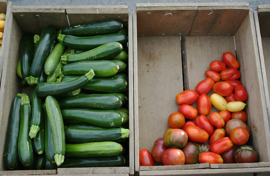 Fresh zucchini and tomatoes at farmers market