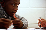 Alie Kamara, left, a student at Montgomery College, brainstorms ideas for his final project with classmates in his Basic Writing II class at the Takoma Campus on Dec. 11, 2012. If students pass this class, it allows them to progress to the college level english program. Otherwise students will face the decision to take the remedial class again or drop out.