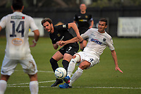 Auckland's Mario Bilen (4) gets his pass away under pressure from Leonardo Villa during the Oceania Football Championship final (second leg) football match between Team Wellington and Auckland City FC at David Farrington Park in Wellington, New Zealand on Sunday, 7 May 2017. Photo: Dave Lintott / lintottphoto.co.nz
