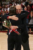 STANFORD, CA - FEBRUARY 7:  Andy Geiger hugs Tara VanDerveer as members of the 1990 National Championship team reunite during Stanford's 77-39 win over USC on February 7, 2010 at Maples Pavilion in Stanford, California.