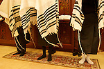 Israel, Bnei Brak. The Synagogue of the Premishlan congregation on Purim holiday, the Priests with their shoes off during the Priestly Blessing prayer, 2005<br />