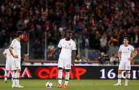 Calcio, Serie A: Roma vs Milan. Roma, stadio Olimpico, 25 aprile 2014.<br /> From left, AC Milan's Ricardo Kaka', of Brazil, Mario Balotelli and Riccardo Montolivo react after AS Roma scored the second goal during the Italian Serie A football match between AS Roma and AC Milan at Rome's Olympic stadium, 25 April 2014.<br /> UPDATE IMAGES PRESS/Riccardo De Luca