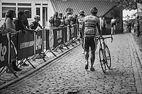 an unlucky Stijn Steels (BEL/Topsport Vlaanderen - Baloise) walking up the infamous Muur van Geraardsbergen cobbles as he broke his chain coming up (& no team cars are allowed up the Muur & they await the riders at the backside of the hill)<br /> <br /> 12th Eneco Tour 2016 (UCI World Tour)<br /> Stage 7: Bornem › Geraardsbergen (198km)