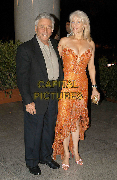 PETER FALK & SHIRA.David Di Donatella Awards.full length, full-length, orange dress, cleavage, plunging neckline.www.capitalpictures.com.sales@capitalpictures.com.© Capital Pictures.