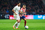 Angel Martin Correa of Atletico de Madrid and Ismail Koybasi of Granada CF during La Liga match between Atletico de Madrid and Granada CF at Wanda Metropolitano Stadium in Madrid, Spain. February 08, 2020. (ALTERPHOTOS/A. Perez Meca)