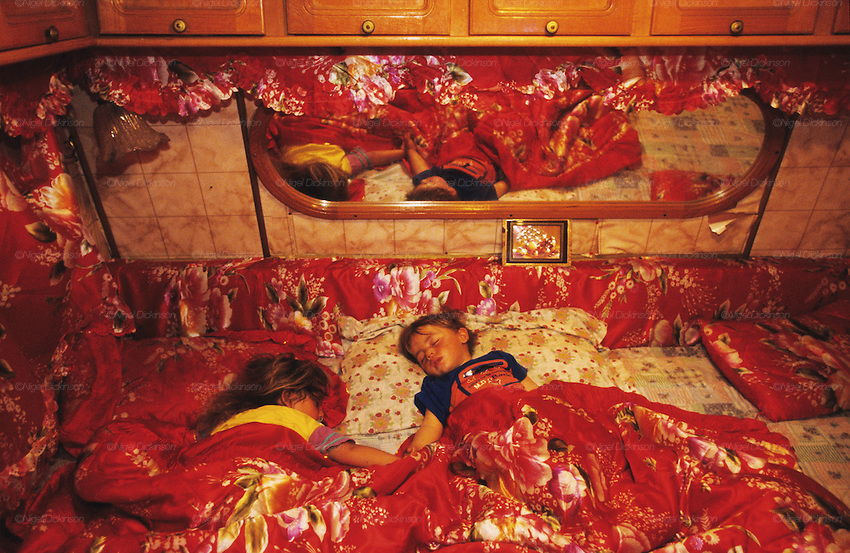 Croat Roma brother and sister, asleep in caravan. Their families are economic refugees seeking a better life abroad. Rome, Italy 2001