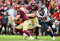 Landover, MD - November 18, 2018: Washington Redskins quarterback Colt McCoy (12) is pressured by Houston Texans defensive end J.J. Watt (99) during second half action of game between the Houston Texans and the Washington Redskins at FedEx Field in Landover, MD. The Texans defeated the Redskins 23-21. (Photo by Phillip Peters/Media Images International)