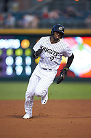 Luis Robert (9) of the Charlotte Knights hustles towards third base against the Scranton/Wilkes-Barre RailRiders at BB&T BallPark on August 13, 2019 in Charlotte, North Carolina. The Knights defeated the RailRiders 15-1. (Brian Westerholt/Four Seam Images)
