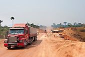 Para State, Brazil. Trucks on the BR163 road with road building.