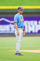 Myrtle Beach Pelicans manager Jason Wood (40) coaches third base during the Carolina League game against the Winston-Salem Dash at BB&T Ballpark on July 7, 2013 in Winston-Salem, North Carolina.  The Pelicans defeated the Dash 6-5 in 8 innings in game two of a double-header.  (Brian Westerholt/Four Seam Images)