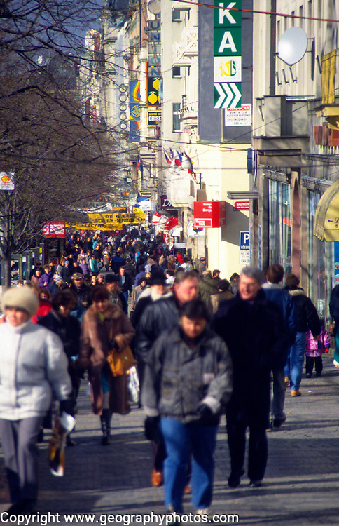 People walking along shopping street in winter clothes, Prague, Czech Republic