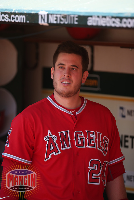 OAKLAND, CA - APRIL 30:  C.J. Cron #24 of the Los Angeles Angels stands in the dugout before the game against the Oakland Athletics at O.co Coliseum on Thursday, April 30, 2015 in Oakland, California. Photo by Brad Mangin