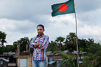 Union Council Chairman Akram Hossain poses for a portrait at the Gazipur Union Council Office overlooking Gazipur village, Upazila Sreepur, Gazipur, Bangladesh on 21st September 2011. Hossain, who has been the Chairman for only 3 months tells an action-packed account of a child marriage happening in his relative's family that he personally stopped just 10 days ago. The girl was 13 years old and was a victim of severe eve-teasing, a common reason that young girls are married early, as eve-teasing could translate to social disgrace of the victimised girl's family. Photo by Suzanne Lee for The Guardian