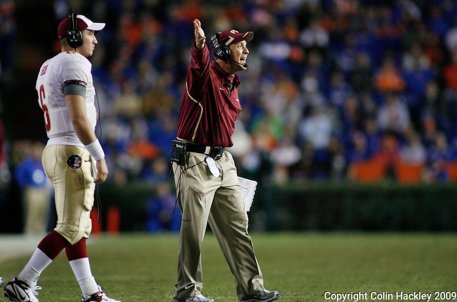 GAINESVILLE, FL 11/28/09-FSU-UF FB09 CH52-Florida State Offensive Coordinator Jimbo Fisher directs his team against Florida during second half action Saturday at Florida Field in Gainesville. The Gators beat the Seminoles 37-10..COLIN HACKLEY PHOTO