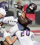 The Lindenwood Lynx football team hosted the Olivet Nazarene Tigers in an NAIA football game on Saturday afternoon. It was the homecoming game for the Lynx. Here, Lindenwood RB Kam Harris (22) rolls over the back of would be Olivet Nazarene tacklers including Drew Philson (20) at right in the first half.