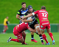 Charlie Ewels of Bath Rugby takes on the Scarlets defence. Pre-season friendly match, between the Scarlets and Bath Rugby on August 20, 2016 at Eirias Park in Colwyn Bay, Wales. Photo by: Patrick Khachfe / Onside Images