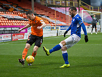 16th November 2019; Tannadice Park, Dundee, Scotland; Scottish Championship Football, Dundee United versus Queen of the South; Liam Smith of Dundee United clears from Stephen Dobbie of Queen of the South  - Editorial Use