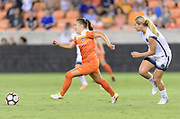 Houston, TX - Saturday July 08, 2017:  Andressa Cavalari Machry brings the ball up the field during a regular season National Women's Soccer League (NWSL) match between the Houston Dash and the Portland Thorns FC at BBVA Compass Stadium.