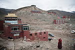 A monk standing in front of what used to be a big monastary complex in Yushu before the 7.1 richter earthquake happened 2010.