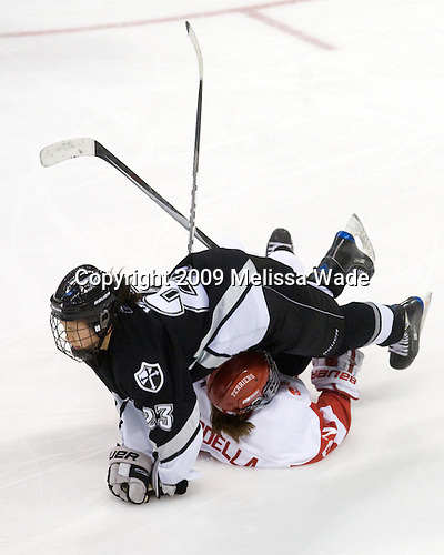 Amber Yung (Providence - 23), Jill Cardella (BU - 22) - The Boston University Terriers defeated the Providence College Friars 5-3 on Saturday, November 14, 2009, at Agganis Arena in Boston, Massachusetts.