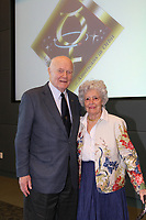 Former United States Senator John H. Glenn (Democrat of Ohio) and his wife Annie are seen at a Senior Manager luncheon, Friday, February 17, 2012, inside the Operations Support Building II at NASA's Kennedy Space Center in Cape Canaveral, Fla. Friday marked Mrs. Glenn's 92nd birthday.  <br /> half length grey gray suit<br /> CAP/ADM<br /> ©NASA/CNP/AdMedia/Capital Pictures