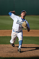 Scott Burke (10) of the UCLA Bruins pitches against the Texas Longhorns at Jackie Robinson Stadium on March 12, 2016 in Los Angeles, California. UCLA defeated Texas, 5-4. (Larry Goren/Four Seam Images)