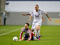 CARSON, CA - March 17, 2012: Chivas USA defender Heath Pearce (3) and Vancouver Whitecaps FC forward Eric Hassli (29) during the Chivas USA vs Vancouver Whitecaps FC match at the Home Depot Center in Carson, California. Final score Vancouver Whitecaps 1, Chivas USA 0.