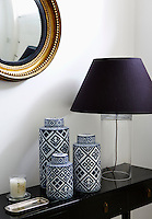 A collection of blue and white contemporary ginger jars graces the console table in the entrance hall