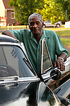 African man with his classic Cadillac