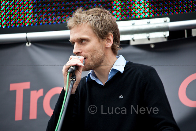 Dave Randall (Faithless and Slovo guitarist, producer and composer).<br /> <br /> London, 08/10/2011. Today Trafalgar Square was the stage of the &quot;Antiwar Mass Assembly&quot; organised by The Stop The War Coalition to mark the 10th Anniversary of the invasion of Afghanistan. Thousands of people gathered in the square to listen to speeches given by journalists, activists, politicians, trade union leaders, MPs, ex-soldiers, relatives and parents of soldiers and civilians killed during the conflict, and to see the performances of actors, musicians, writers, filmmakers and artists. The speakers, among others, included: Jeremy Corbin, Joe Glenton, Seumas Milne, Brian Eno, Sukri Sultan and Shadia Edwards-Dashti, Hetty Bower, Mark Cambell, Sanum Ghafoor, Andrew Murray, Lauren Booth, Kate Hudson, Sami Ramadani, Yvone Ridley, Mark Rylance, Dave Randall, Roger Lloyd-Pack, Rebecca Thorn, Sanasino al Yemen, Elvis McGonagall, Lowkey (Kareem Dennis), Tony Benn, John Hilary, Bruce Kent, John Pilger, Billy Hayes, Alison Louise Kennedy, Joan Humpheries, Jemima Khan, Julian Assange, Lindsey German, George Galloway. At the end of the speeches a group of protesters marched toward Downing Street where after a peaceful occupation the police made some arrests.
