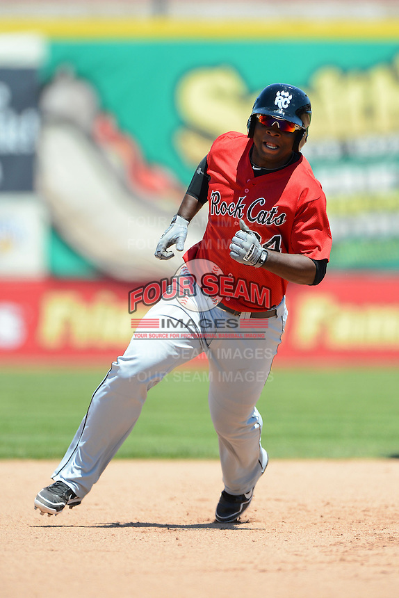 New Britain Rock Cats third baseman Miguel Sano #24 runs the bases during a game against the Erie Seawolves on June 20, 2013 at Jerry Uht Park in Erie, Pennsylvania.  New Britain defeated Erie 2-0.  (Mike Janes/Four Seam Images)