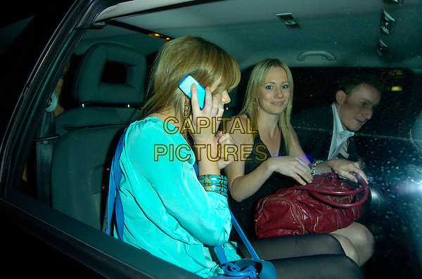 """HANNAH TOINTON & KELLIE SHIRLEY.""""In the Hands of the Gods"""" World Charity Film Premiere, Odeon West End Cinema, Leicester Square, London, England, 10th September 2007..half length in car on mobile phone.CAP/CAN.©Can Nguyen/Capital Pictures"""