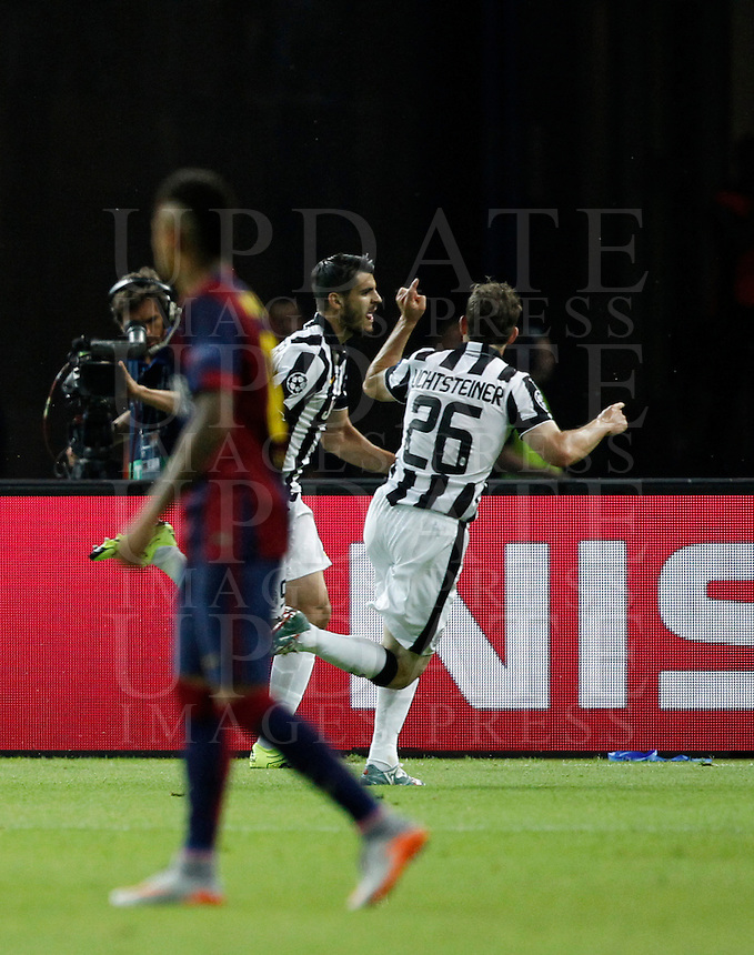 Calcio, finale di Champions League Juventus vs Barcellona all'Olympiastadion di Berlino, 6 giugno 2015.<br /> Juventus' Alvaro Morata, center, celebrates with teammate Stephan Lichsteiner after scoring the equalizer goal during the Champions League football final between Juventus Turin and FC Barcelona, at Berlin's Olympiastadion, 6 June 2015. Barcelona won 3-1.<br /> UPDATE IMAGES PRESS/Isabella Bonotto