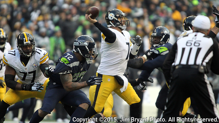 Pittsburgh Steelers quarterback Ben Roethlisberger (7) passes under pressure from Seattle Seahawks defensive end Michael Bennett (72) at CenturyLink Field in Seattle, Washington on November 29, 2015.  The Seahawks beat the Steelers 39-30.      ©2015. Jim Bryant Photo. All Rights Reserved.