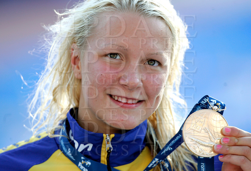 Sweden's Sarah Sjostrom shows the gold medal after setting the new world record clocking 56.06 in the women's 100 meters butterfly event at the Swimming World Championships in Rome, 27 July 2009..UPDATE IMAGES PRESS/Riccardo De Luca