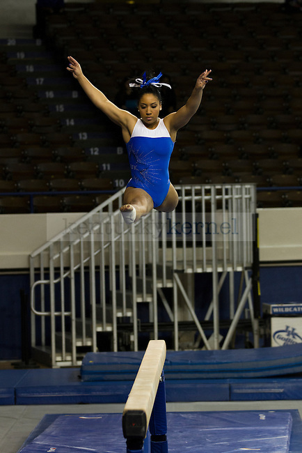 Sophomore Shannon Mitchell competes in the balance beam. in Lexington, Ky., on Thursday, December, 6, 2012. Photo by James Holt | Staff