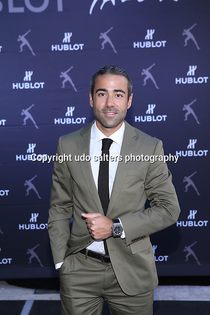 Ricardo Guadalupe, Hublot CEO, hosts the Unveiling of Hublot Design District Boutique and a Special Charity Sprint with Brand Ambassador and &quot;The Fastest Person Ever&quot; USAIN BOLT Wearing the Ricardo Guadalupe, Hublot CEO, hosts the Unveiling of Hublot Design District Boutique and a Special Charity Sprint with  Brand Ambassador and &quot;The Fastest Person Ever&quot; USAIN BOLT Wearing King Power<br />