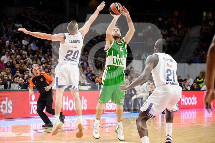 Real Madrid's player Jaycee Carroll and Othello Hunter and Unics Kazan's player Kostas Kaimakoglou during match of Turkish Airlines Euroleague at Barclaycard Center in Madrid. November 24, Spain. 2016. (ALTERPHOTOS/BorjaB.Hojas)
