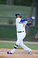 Michael Medina #37 of the AZL Dodgers bats against the AZL Padres at Camelback Ranch on July 8, 2014 in Glendale, Arizona. AZL Dodgers defeated the AZL Padres, 17-1. (Larry Goren/Four Seam Images)