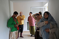 """Members of the Roma or gypsy theater Romathan stand backstage before entering the gymnasium to perform for young children the play """"Dwarf"""" at the Banske Elementary School with a Roma or gypsy majority student body in Banske, Slovakia on June 2, 2010."""
