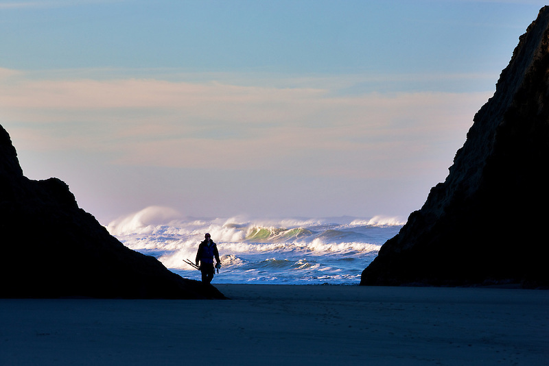 Waves and rock with photographer at Bandon Beach. Oregon