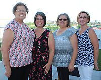 NWA Democrat-Gazette/CARIN SCHOPPMEYER Leola Johnson (from left), Kelly Chronister, Jackie Myers and Carol Bishop, Dress for Success volunteers gather June 18.