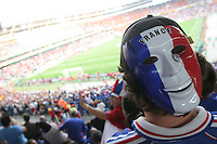 A French National soccer team supporters wears a smiling France mask on the back of his head before France and Spain's  second round FIFA World Cup match in Hannover, Germany  on Tuesday, June 27th 2006.  France defeated Spain 3-1.
