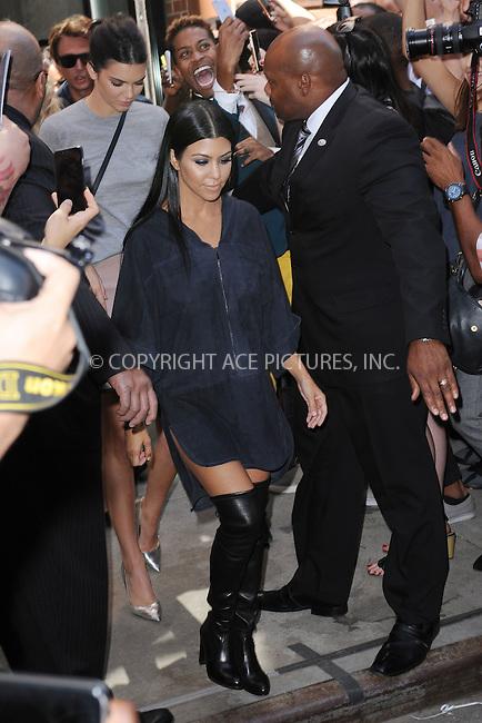 WWW.ACEPIXS.COM<br /> September 16, 2015 New York City<br />  <br /> Kendall Jenner and Kourtney Kardashian leaving Kanye West Fashion Show on September 16, 2015 in New York City.<br /> <br /> <br /> <br /> Credit: Kristin Callahan/ACE<br />  <br /> Tel: 646 769 0430<br /> Email: info@acepixs.com<br /> www.acepixs.com