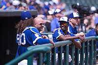 Oklahoma City Dodgers players, including Darnell Sweeney, joke around in the dugout in a game against the Iowa Cubs at Chickasaw Bricktown Ballpark on April 9, 2016 in Oklahoma City, Oklahoma.  Oklahoma City defeated Iowa 12-1 (William Purnell/Four Seam Images)