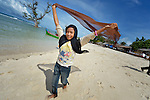 Ten-year old Fathan Nur Selani plays on the beach at Lhok Me, in Indonesia's Aceh province. The girl's mother sells coconuts and soft drinks to tourists on the beach. The 2004 tsunami struck the coastal village when Fathan was just three weeks old. YEU, a member of the ACT Alliance, worked with the village to build new houses in a safer area, as well as help revitalize their income generating activities, including Fathan's mother's small business. The tsunami killed 221,000 people in Aceh province and left more than 500,000 displaced.<br /> <br /> Parental consent obtained.