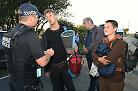 Pictured: Police officers speak to the climate protesters are leaving after having blocked access to the Valero refinery in Pembroke Dock, Wales, UK. Thursday 19 September 2019<br /> Re: Ten Extinction Rebellion climate change protesters have blocked three entrances of the Valero site in Pembroke Dock, Pembrokeshire, one of the biggest oil refineries in Europe.<br /> Protesters have attached themselves to wooden boxes filled with concrete in a bit to stop vehicles from entering or leaving the site.