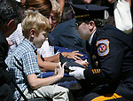 Funeral for North Brunswick Police Lt. Chris Zerby at the Franklin Memorial Park , North Brunswick. Here the police hat of Lt. Chris Zerby is handed to his son Tyler (left) during the service at the park.<br /> METRO<br /> 3066<br /> ON SAT AUG.2, 2008<br /> MARK R. SULLIVAN/CHIEF PHOTOGRAPHER