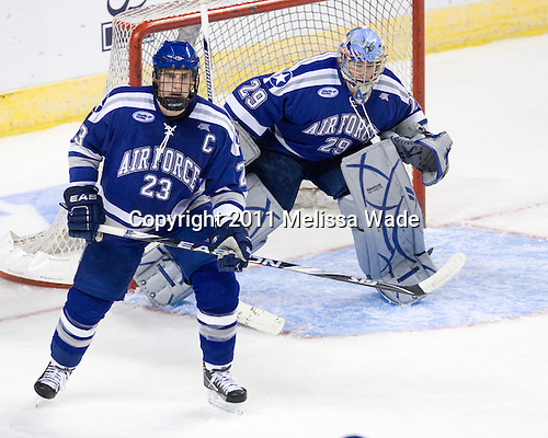 Scott Mathis (Air Force - 23), Jason Torf (Air Force - 29) - The Yale University Bulldogs defeated the Air Force Academy Falcons 2-1 (OT) in their East Regional Semi-Final matchup on Friday, March 25, 2011, at Webster Bank Arena at Harbor Yard in Bridgeport, Connecticut.